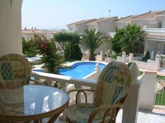 Property Photo: Terrace overlooking the pool