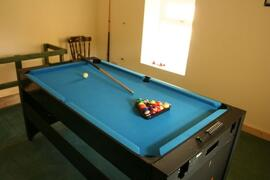 Games Loft with pool/air hockey table, darts board and football table