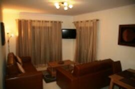 Property Photo: Lounge with 2 sofabeds ,LCD TV