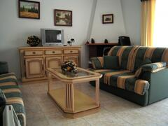 Property Photo: The spacious and comfortable living area.