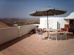 Roof terrace with views across the mountains.