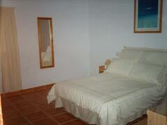 Main bedroom. Has new double bed, two wardrobes (one with drawer space)and dressing-table/chest of drawers.