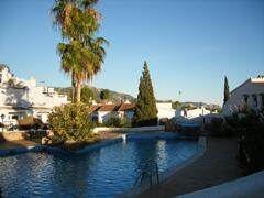 Property Photo: one of the swimming pools