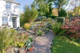 Property Photo: Cottage with garden and seating area
