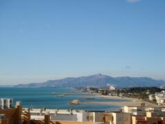 Property Photo: View of the coast of Cambrils and surrounding mountains from sun terrace