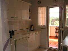 kitchen leading onto breakfast room and private garden