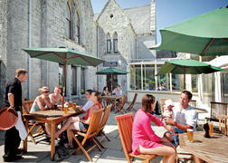 The outdoor Manor Bar open in peak season - Located right next to the outdoor pool