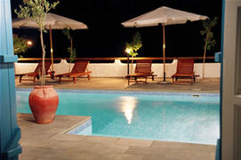 Property Photo: A swimming pool by night