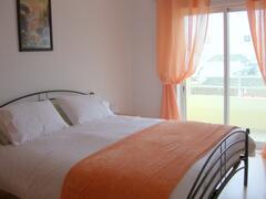 En-suite bedroom with king-size bed