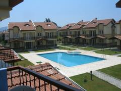 Property Photo: View from balcony of pool and complex