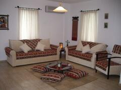 Property Photo: Ottoman Style Lounge Room