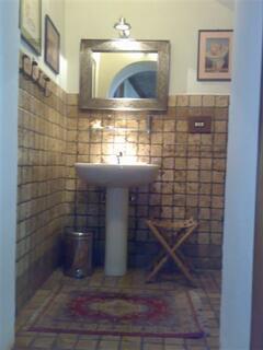 Portico Stone-Tiled Half-Bath