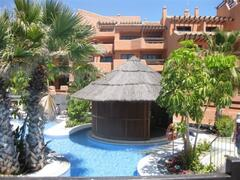 ENJOY COMFORTABLE SETTEES UNDER THATCH-ROOFED CABANAS; small hideaways of peace and tranquillity