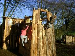 Children's play fort with zip wire