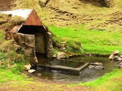 Hrunalaug, natural geothermal pool, close by.