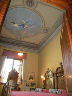 The ceiling of one of the bedrooms inside the Villino