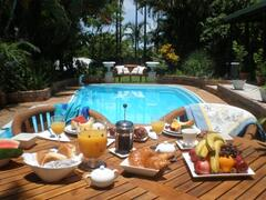 Property Photo: Tropical Breakfast by the pool at Palm Whispers