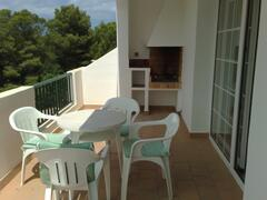Balcony with BBQ, furniture, laundry line