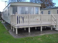 A 2 bedroom, double glazed caravan with deck.
