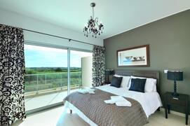 Bedroom with queen size bed. Also bedroom has built in wardrobes.