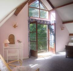 Master bedroon with french doors over looking the lake