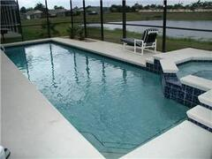 Property Photo: occupies a south-west facing lot and has a large sun deck around the pool.