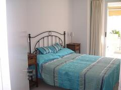 Bedroom with large double bed, plenty of wardrobe space