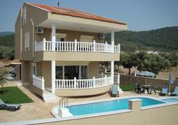 Property Photo: Villa Helios, built to a high specification with a contemporary interior.