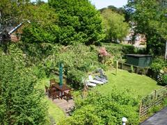 Longbow Barns Upper Apartment garden, with views of the River Dart estuary and out to sea..