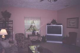 Property Photo: Big screen TV VCR DVD and Satelittle and 300 movies in collection to chooose from