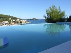 Swim in pool with sea view
