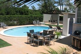 Property Photo: Pool and garden area
