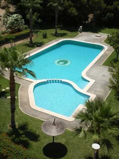 Property Photo: Beautifully Kept Gardens & Gated Pool