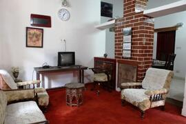 Property Photo: The living room is furnished with old British furniture and  has a fire place.