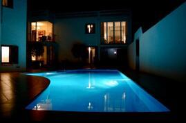 Pool & House at Night
