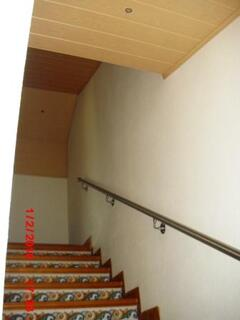 the staircase with wood work, rail and ceramic deco