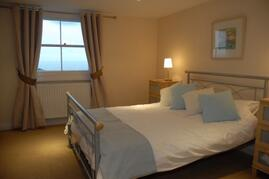 Property Photo: Master bedroom which enjoys panoramic sea views