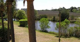 Property Photo: View from the private porch across the lagoons, marsh and out to the ocean!