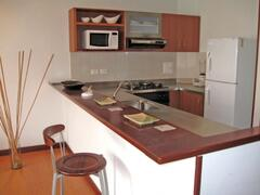 Property Photo: Breakfast bar & kitchen