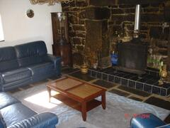 lounge with beams, flagstones and granite fireplace