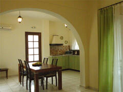 There is a large dining table centring the room, between kitchen area and sitting room.