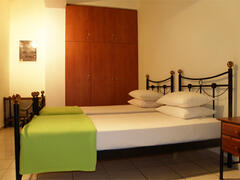 Situated at the back of the house,  off of the dressing area, the second bedroom is fully furnished with wardrobe, vanity with mirror and two single beds.