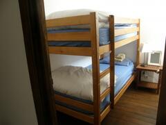 Twin L-Shaped Bedroom