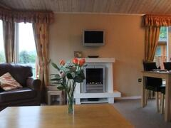 The lounge is superbly fitted with comfortable furniture (leather three seater settee, armchair, coffee table
