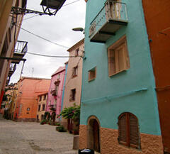 Property Photo: Set in a beautiful street awash with colours, Dommu Asuletta is in blue in the foreground