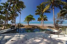 Lovely pool surrounded by mature coconut palms