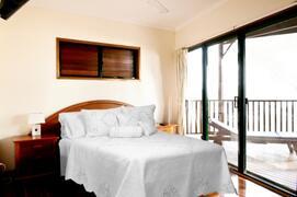 Downstairs 2nd Bedroom (total 3 bedrooms) With Queen Bed & Huge Deck With Stunning Ocean Views