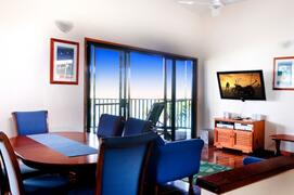 Large LCD TV With Austar. Comfortable Furnishings & Tropical Holiday Decor