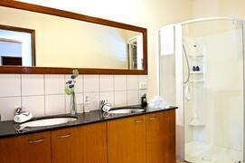 Two Spacious Bathrooms, One With Double Sink & Shower, The Other With Single Sink & Shower