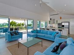 Large Lounge Room Opens Up To Spacious Deck Via Sliding Doors